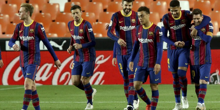 Barcelona's Lionel Messi celebrates with team mates scoring his side's 3rd goal during the Spanish La Liga soccer match between Valencia and Barcelona at the Mestalla stadium in Valencia, Spain, Sunday, May 2, 2021. (AP Photo/Alberto Saiz)